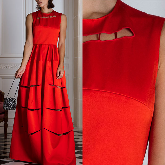 Flame-orange evening gown with couture slash incisions