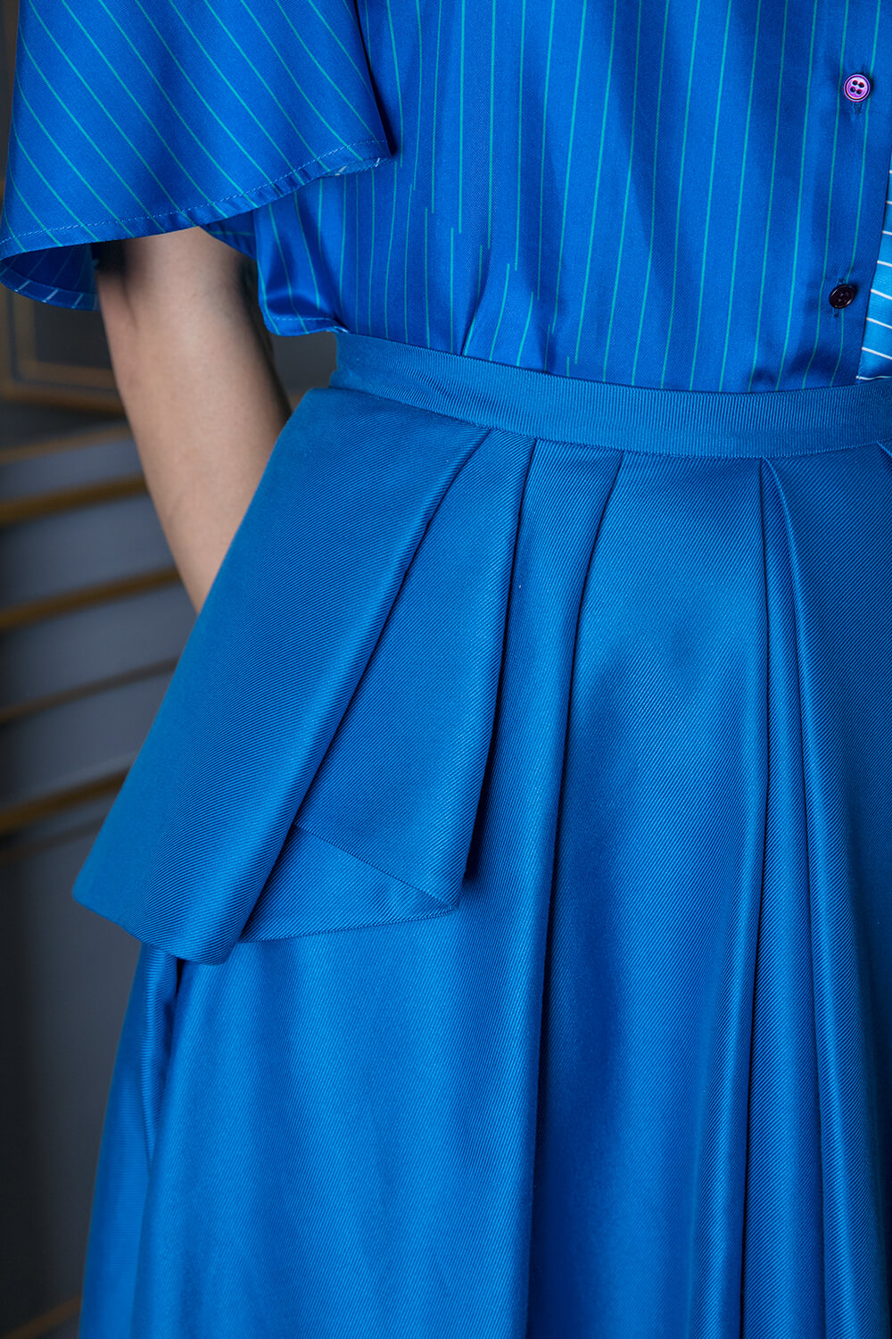 Cobalt blue pleated maxi skirt with peplum hem detail