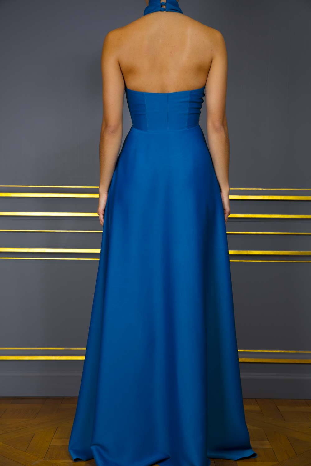 Cerulean blue halter-neck gown with crossover bodice