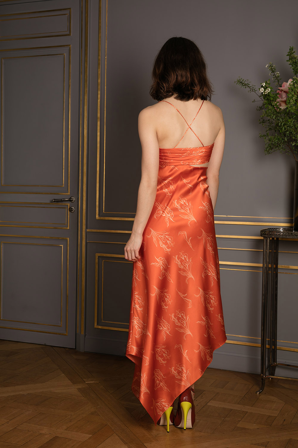 Asymetric orange silk cocktail dress with white floral prints ruched bra and spagetthi straps
